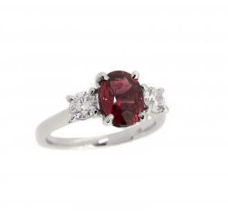 Platinum and diamond and red sapphire trilogy ring